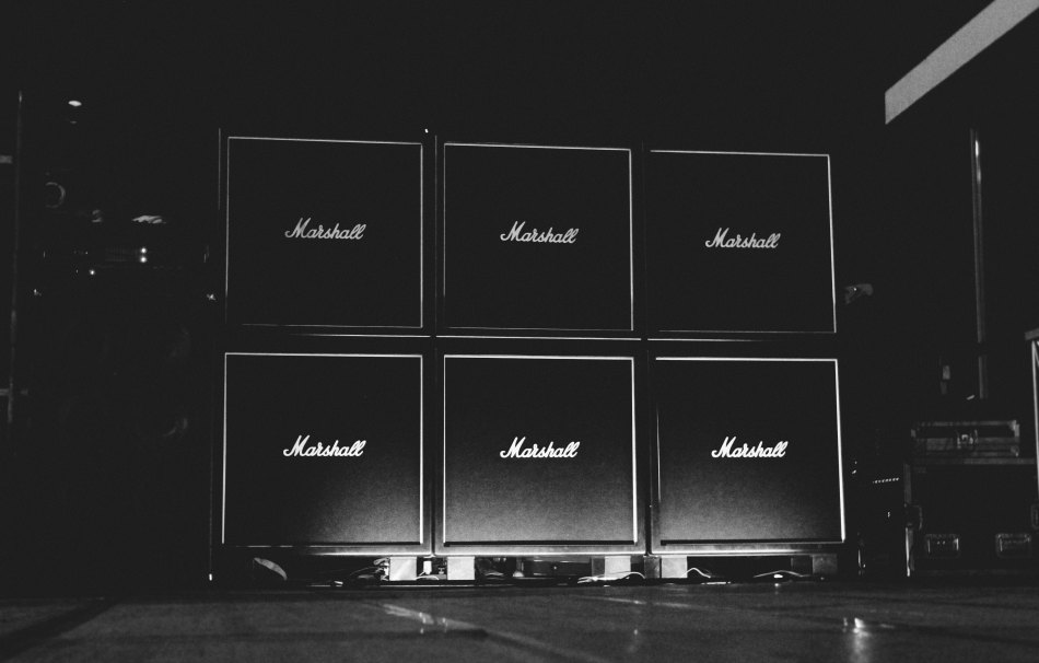 Black and white image of six Marshall speaker cabinets