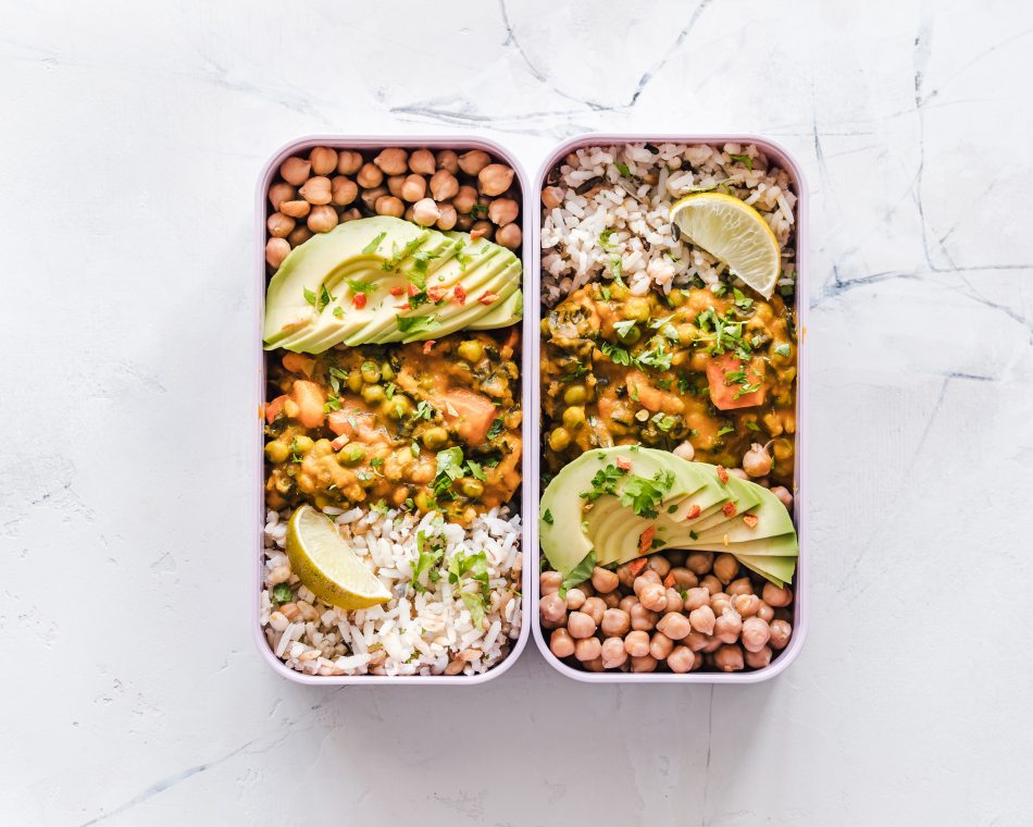 Vegan packed lunch with avocado, chickpeas, rice, and lemon