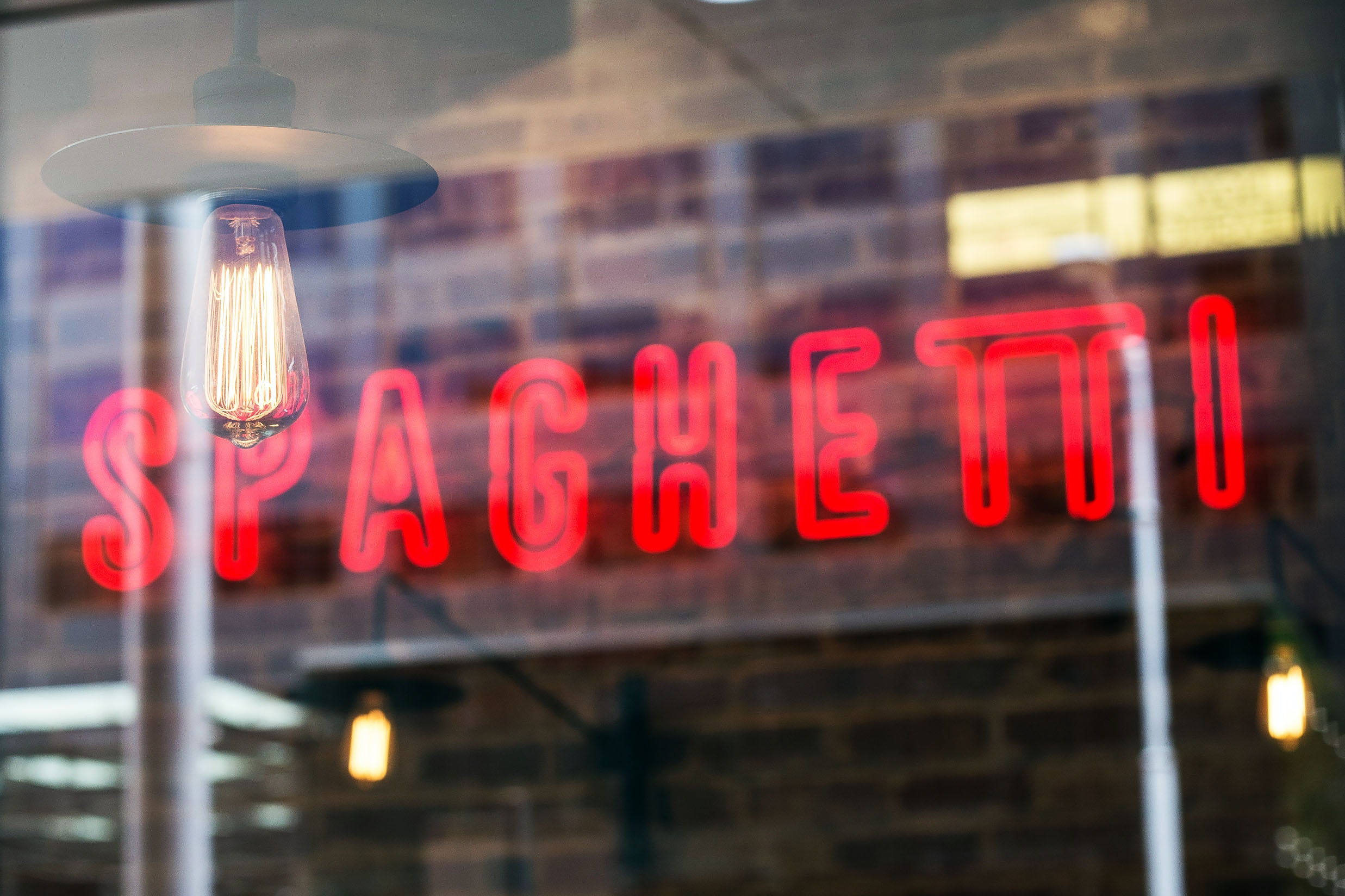 Red neon sign reading Spaghetti