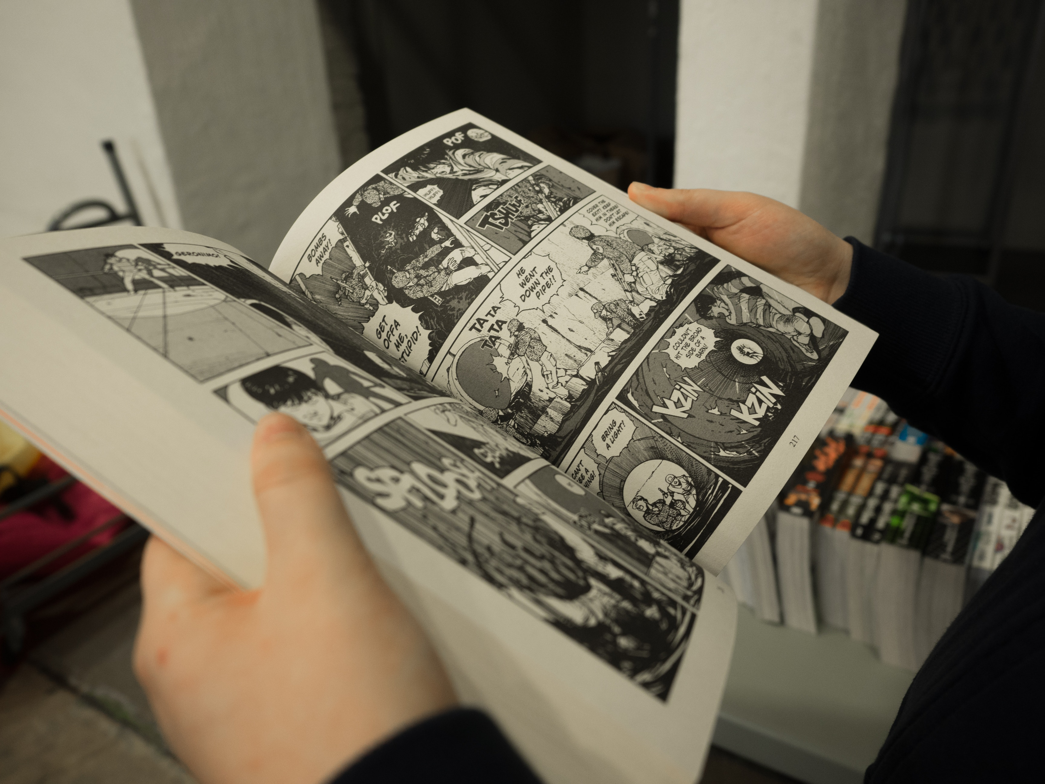 Man reading a manga comic