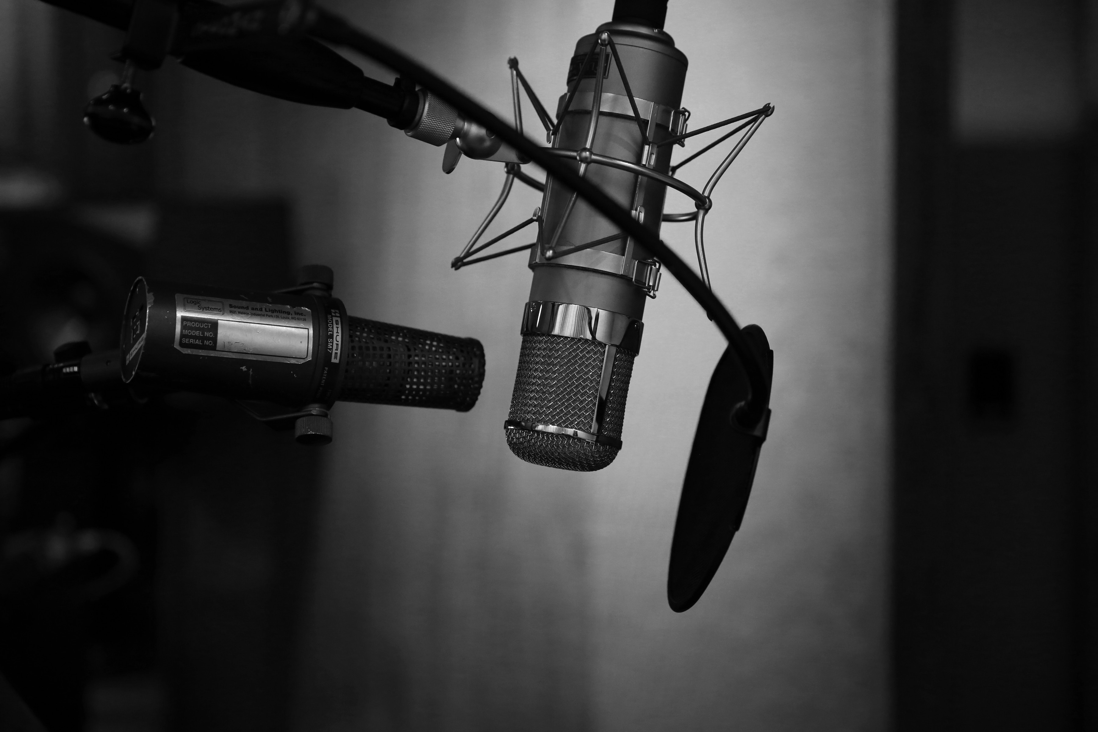 Black and white photo of microphone in sound booth