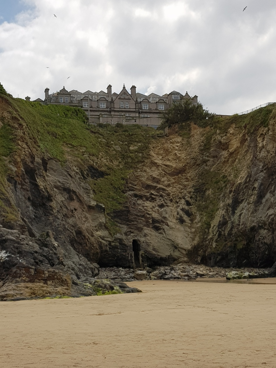 Mansion on top of a cliff on Towan Beach Newquay