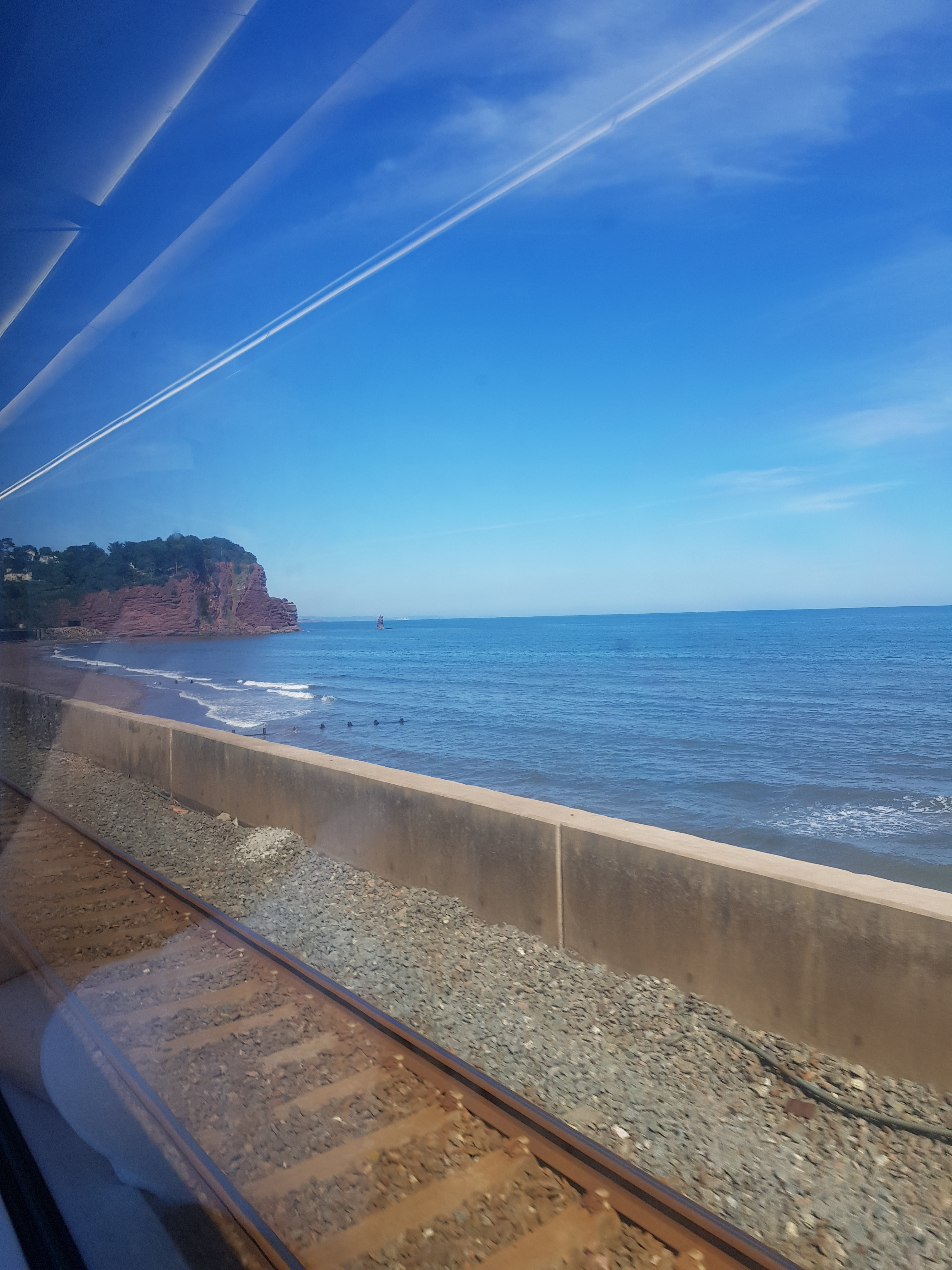 View of the English channel from a train along the south coast of England